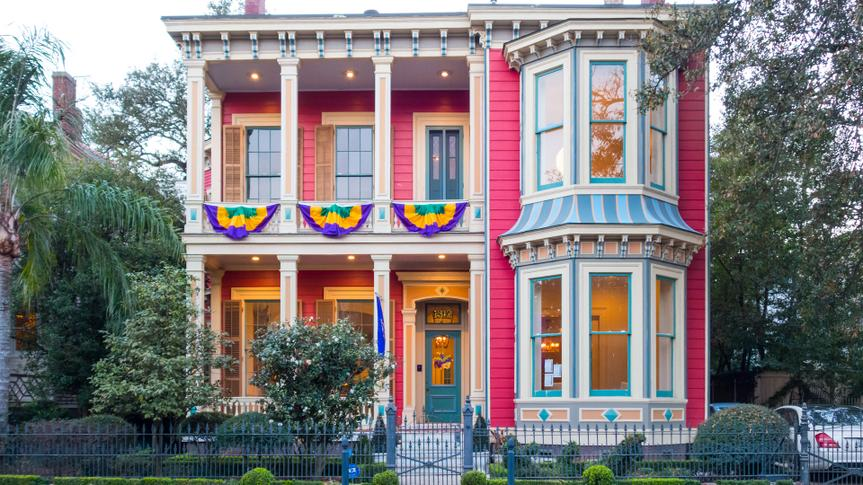 New Orleans, USA - February 7, 2015: Mansion decorated for Mardi Gras in the Garden District of New Orleans, Louisiana.