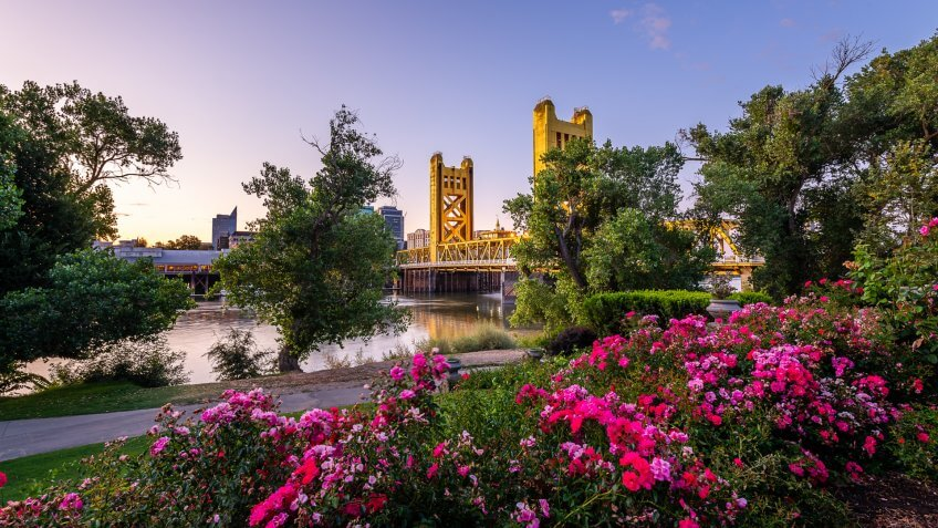 The sun rises over the historical landmarks of West Sacramento, California.