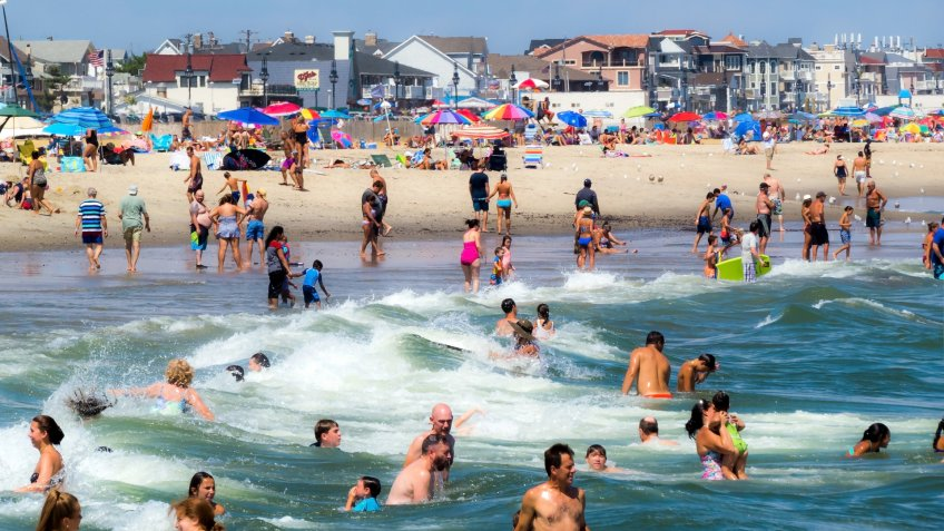 SPRING LAKE, NEW JERSEY-AUGUST 20 - A crowd of sunbathers and swimmers enjoy a warm beach day on August 20 2016 in Spring Lake New Jersey.