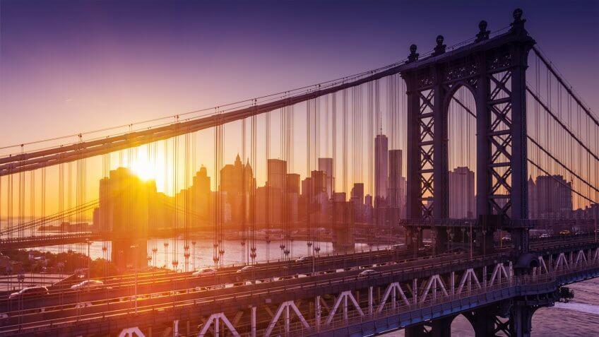 New York City - beautiful sunset over manhattan with manhattan and brooklyn bridge - Image.