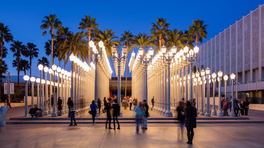 "Los Angeles, California, USA - July 7th, 2016: Visitors at one of LA's landmark the ""Urban Light"" by Chris Burden which is a well-known installation in at LACMA."