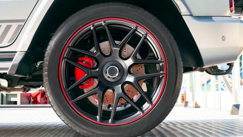 Side view of modern car with rubber tire on wheel rim.