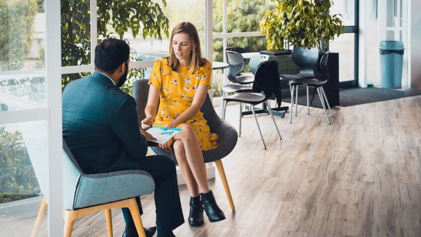 female colleague talking with businessman