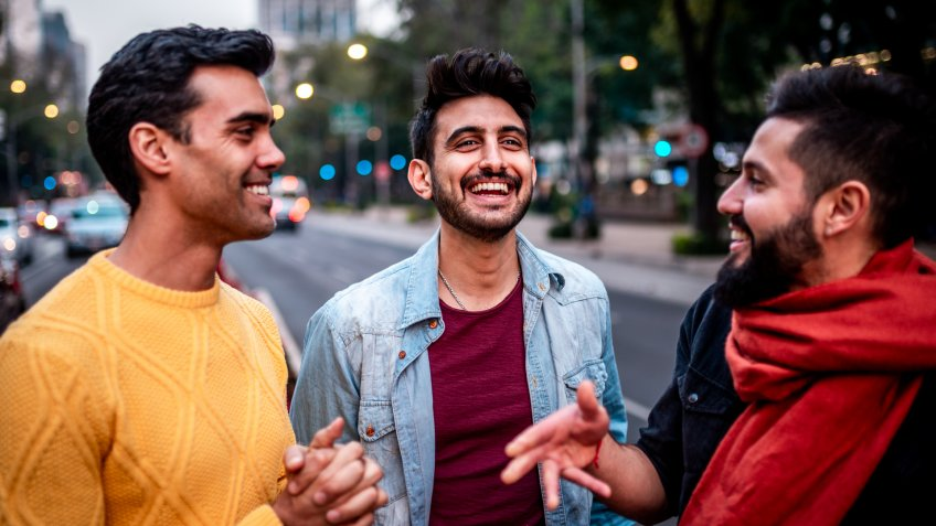 Group of three male friends walking around Mexico city.