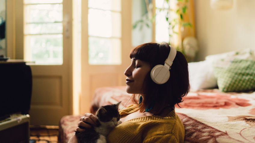 Teenage girl with cat at home relaxing during the weekend.
