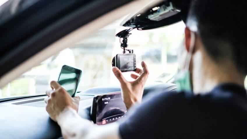 guy turning on dashboard camera
