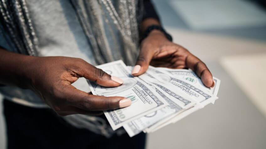 Hands holding a dollar bills
