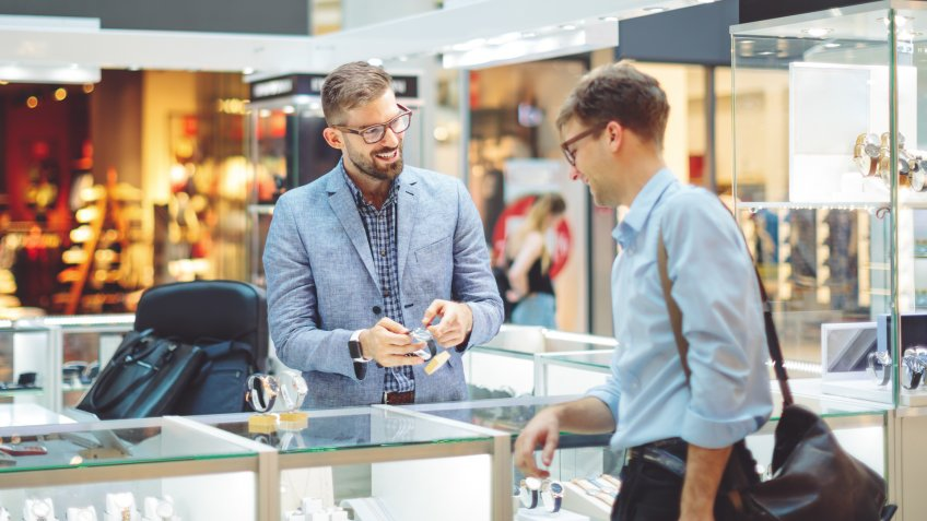 Young man is shopping for a watch.