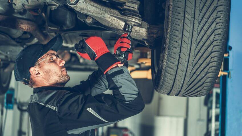 mechanic changing suspension bushings