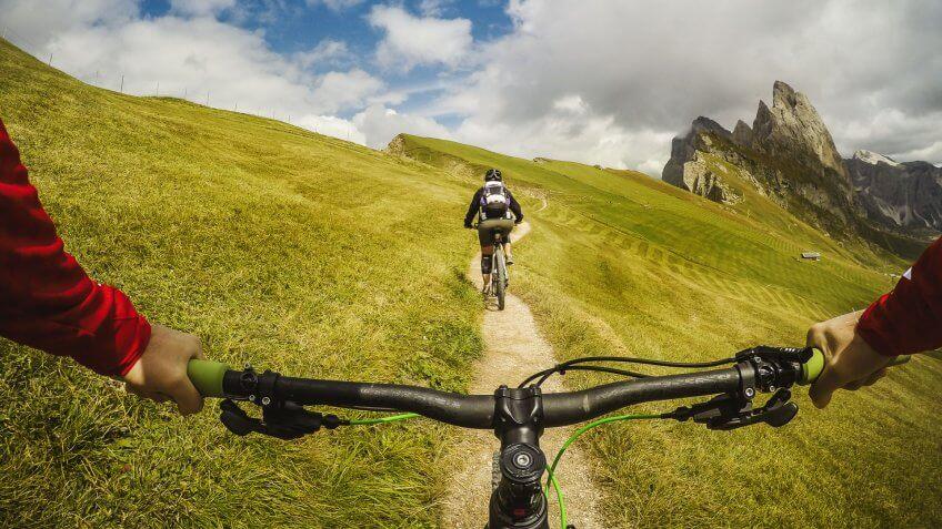 Point of view POV mountain bike on the dolomites.