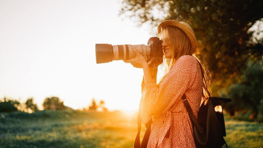 portrait photographer taking photos at sunset