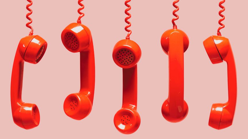 Various views of old red telephone receivers hanging on pink background with texting space, waiting for phone call, customer service concept, vintage telephone receiver.