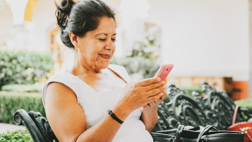 Senior Mexican Woman Using Smart Phone.