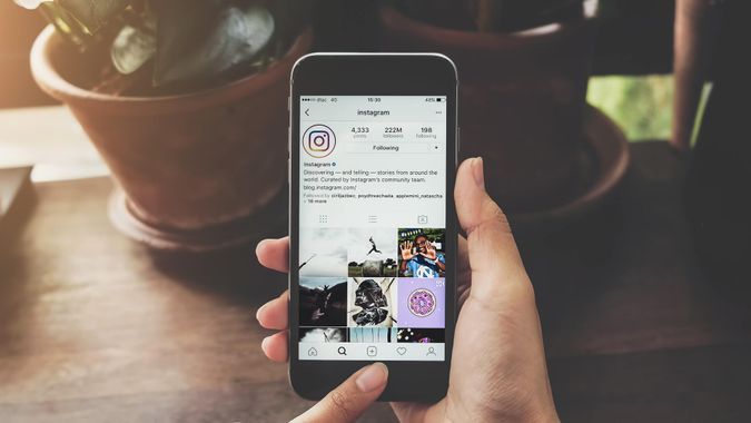 woman using Instagram on smartphone