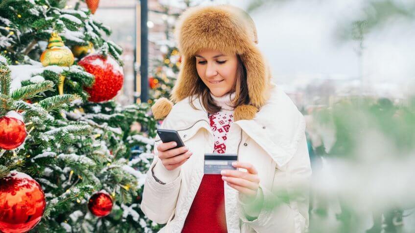 Woman shopping at Christmas market.