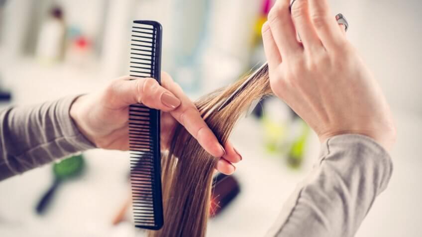 girl getting hair cut