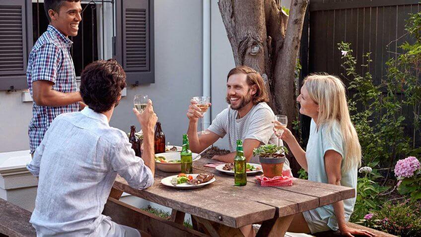 friends eating in backyard