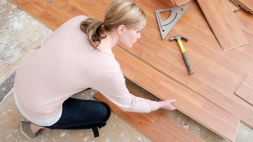 woman placing hardwood floor