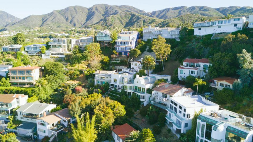 An aerial shot of beach front homes in Malibu, CA.
