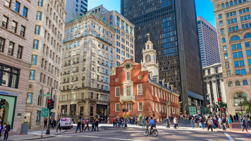 Boston, Massachusetts, USA - October 14, 2016: Pedestrians cross at the Old State House in Boston.
