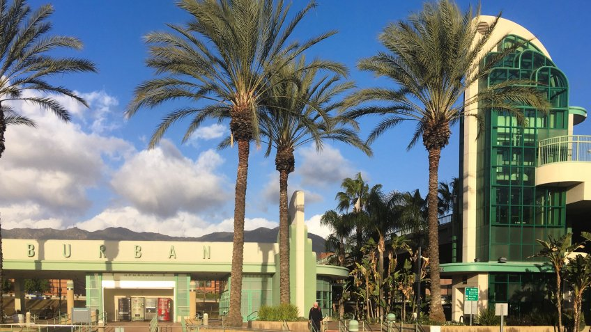 LOS ANGELES, CA, JAN 2017: detail of beautiful art deco Metrolink and Amtrak railway station with palm trees in Downtown Burbank.