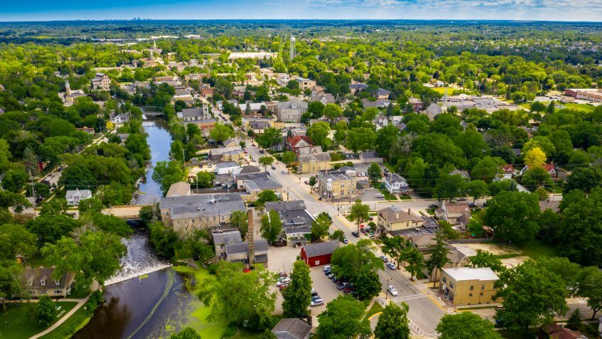 Aerial view of downtown Cedarburg Wisconsin known for its quaint downtown district lined with historic buildings.