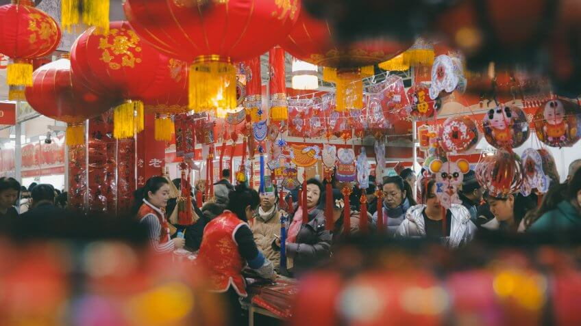 People shop for decorations for the upcoming Chinese Lunar New Year at a market in Beijing, China, 15 January 2020.