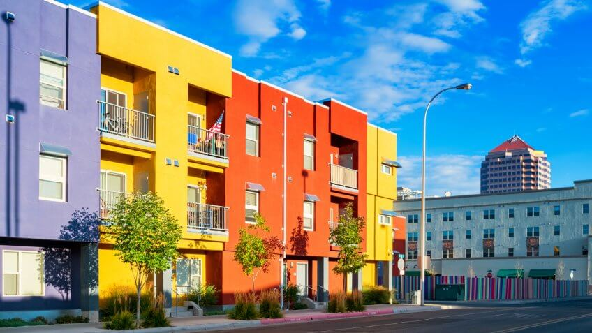 Photo of a city street with new, colorful townhouses in downtown Albuquerque, New Mexico, USA.