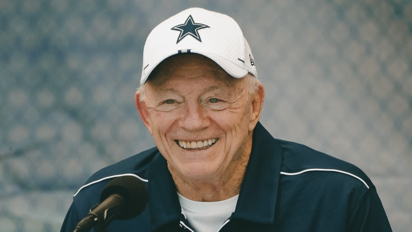 Dallas Cowboys owner Jerry Jones smiles during a press conference at the NFL football team training camp in Oxnard, Calif.