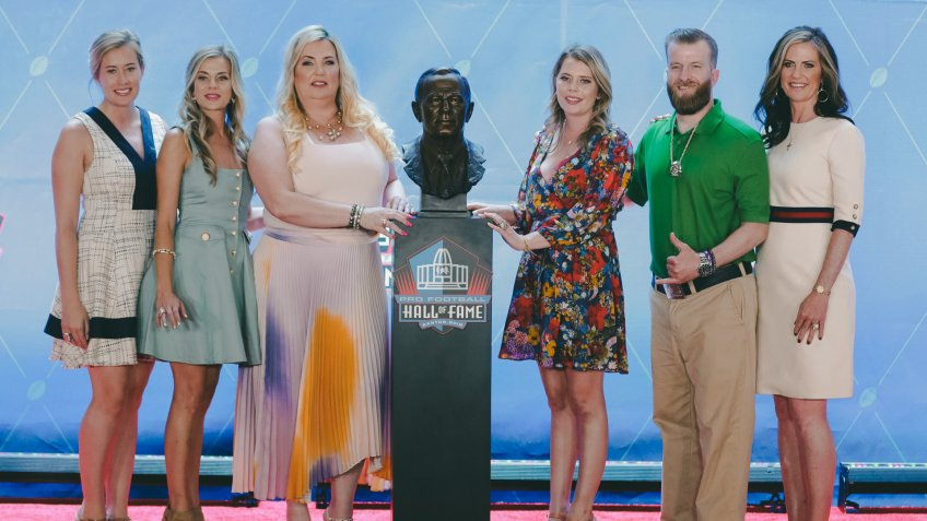 Members of the Bowlen family, from left to right, Brittany Bowlen, Annabel Bowlen, Amie Bowlen Klemmer, Christina Bowlen, Patrick Bowlen and Beth Bowlen Wallace pose with a bust of former Denver Broncos owner Pat Bowlen during the induction ceremony at the Pro Football Hall of Fame in Canton, Ohio.