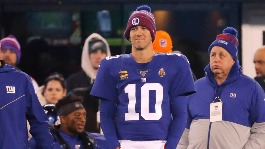 New York Giants quarterback Eli Manning (10) stands on the sidelines in the first half of an NFL football game against the Philadelphia Eagles, in East Rutherford, N.