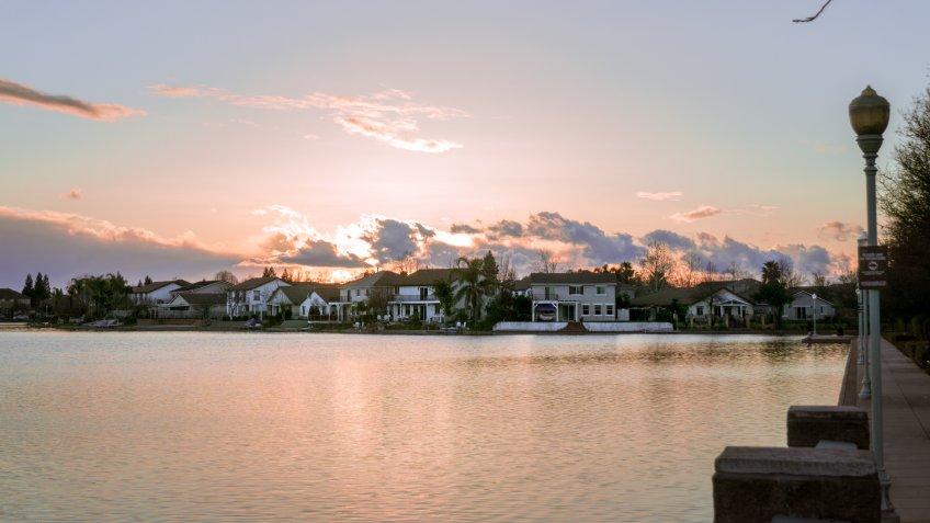 Sunset over man-made lake in Elk Grove California.
