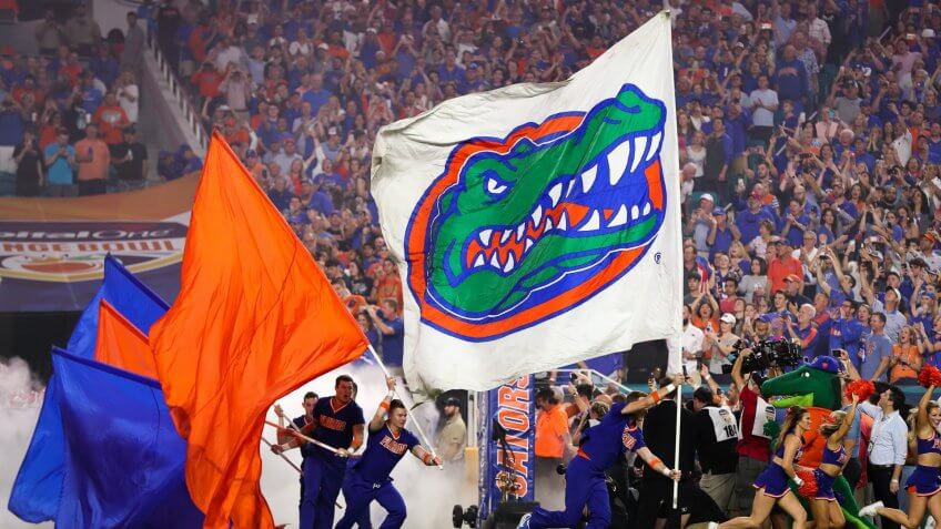 Mandatory Credit: Photo by Mario Houben/CSM/Shutterstock (10515365bh)The Florida Gators display their flags as the football team enters the field for the Capital One Orange Bowl - NCAA Football game against the Virginia Cavaliers at the Hard Rock Stadium in Miami Gardens, Florida.