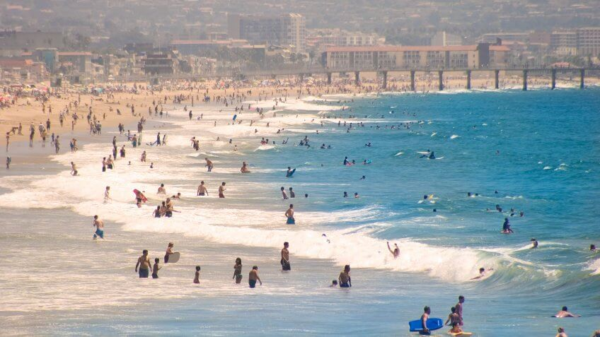 People frolicking on a summer's day at Hermosa Beach, California.