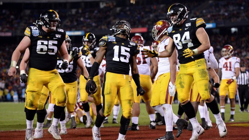 Mandatory Credit: Photo by Orlando Ramirez/AP/Shutterstock (10513794aa)Iowa running back Tyler Goodson (15) celebrates after scoring a touchdown during the second half against Southern California in the Holiday Bowl NCAA college football game, in San Diego.