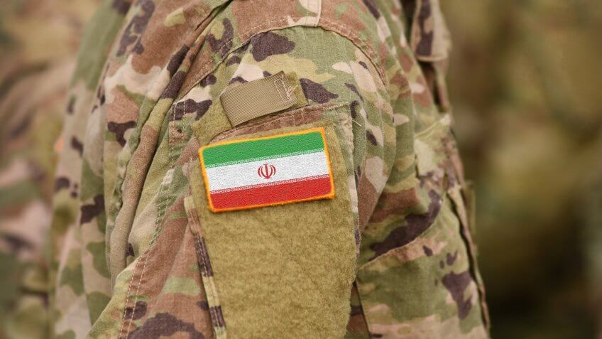Flag of Iran on soldiers arm (collage).