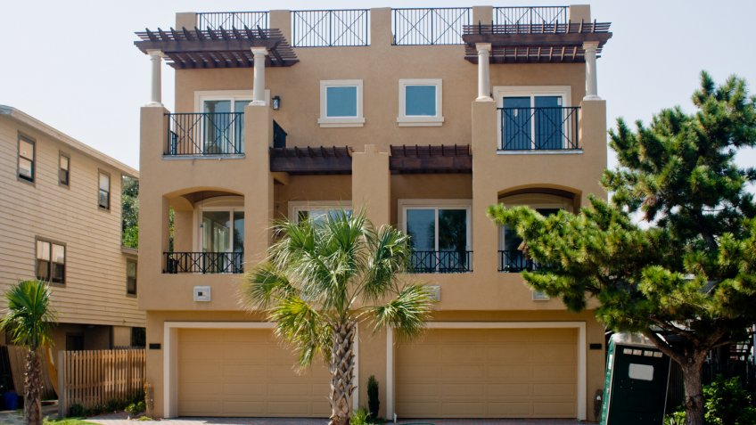 modern, newly constructed beach community home with roof top patio.