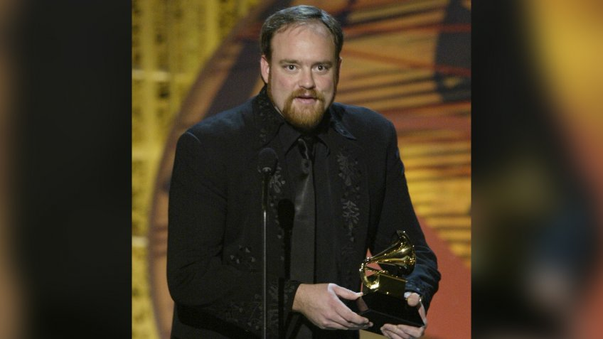 """John Carter Cash, son of country legend June Carter Cash, accepts the award for best short form music video for """"Hurt,"""" featuring Johnny Cash, during the 46th Annual Grammy Awards, in Los AngelesGRAMMYS CEREMONY, LOS ANGELES, USA."""