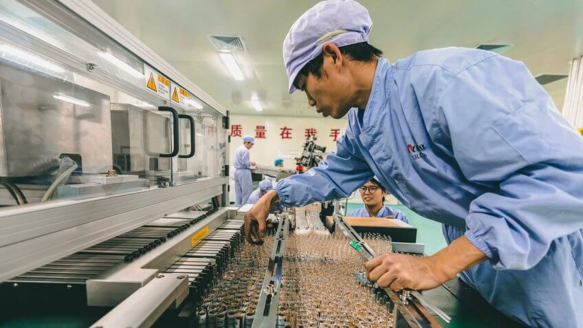 A man works in Kanion Pharmaceutical Chinese traditional medicine production line in Lianyungang, Jiangsu Province, China, 21 May 2019.