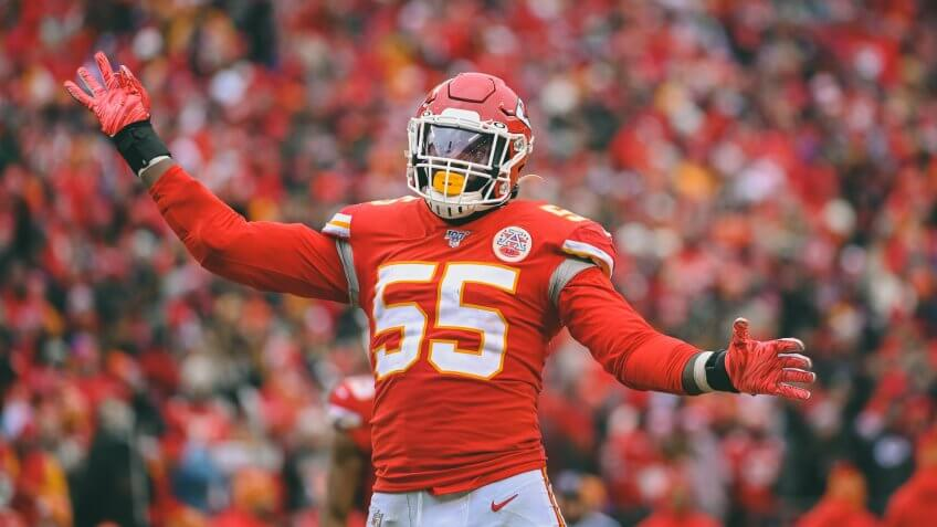 Kansas City Chiefs defensive end Frank Clark (55) tries to fire up the home crowd against the Los Angeles Chargers during the second half of an NFL football game in Kansas City, MoChargers Chiefs Football, Kansas City, USA - 29 Dec 2019.
