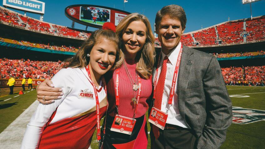 Clark Hunt, owner of the Kansas City Chiefs, his wife Tavia Shackles and their daughter Ava, pose for a photo before an NFL football game between the Kansas City Chiefs and the Houston Texans, in Kansas City, MoTexans Chiefs Football, Kansas City, USA - 13 Oct 2019.