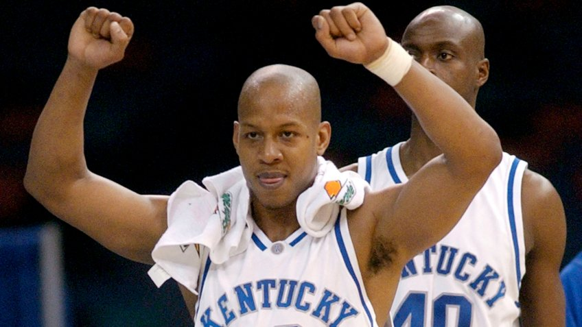Kentucky's Keith Bogans (10) celebrates on the bench with teammate Jules Camara (40) in the second half in the championship of the SEC Conference tournament in the Superdome, in New Orleans.