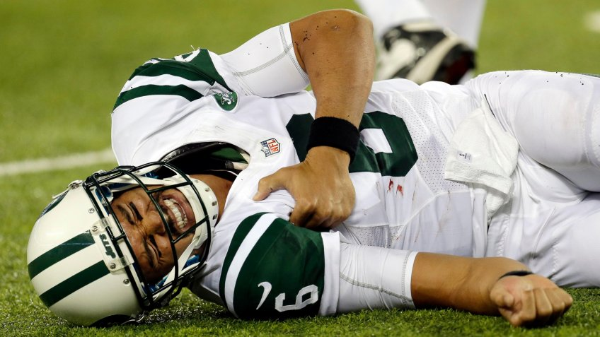 New York Jets quarterback Mark Sanchez (6) reacts to an injury during the second half of a preseason NFL football game against the New York Giants in East Rutherford N.