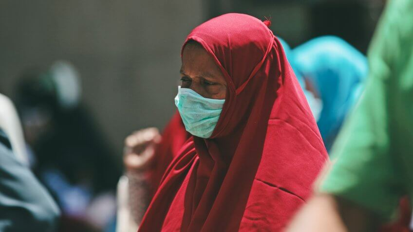 A Muslim pilgrim wears a surgical mask to prevent infection from respiratory virus known as the Middle East respiratory syndrome (MERS) in the holy city of Mecca, Saudi Arabia.