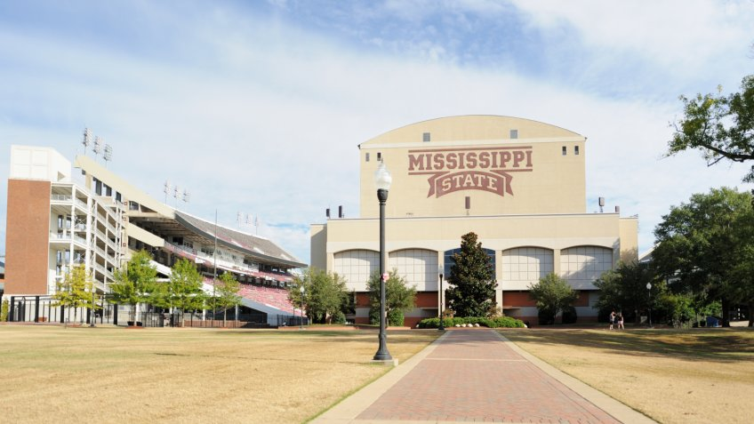 Mississippi State University, Mississippi, USA - October 18, 2014: Looking down sidewalk from the junction towards the sound side of Davis Wade Stadium on the campus of Mississippi State Unviersity, located near the town of Starkville, Mississippi.