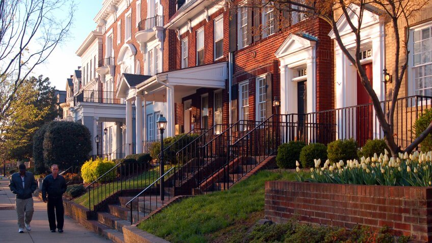 Richmond, VA, USA April 4, 2006 Two adult men walk past the historic homes on Monument Avenue in Richmond, Virginia.