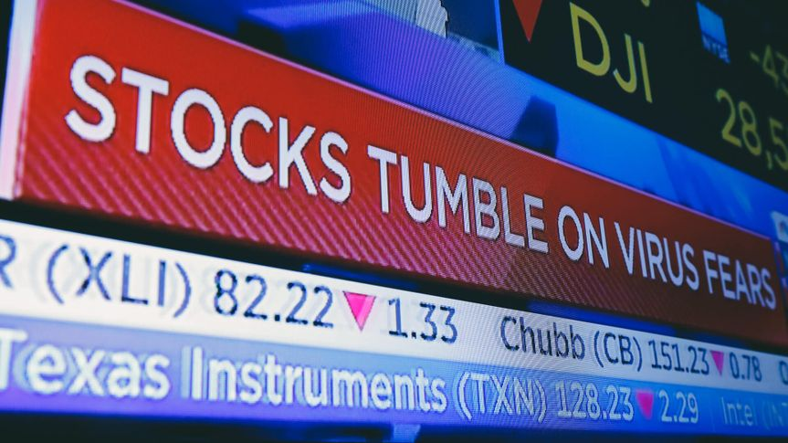 A television screen headlines trading on the floor of the New York Stock Exchange,.