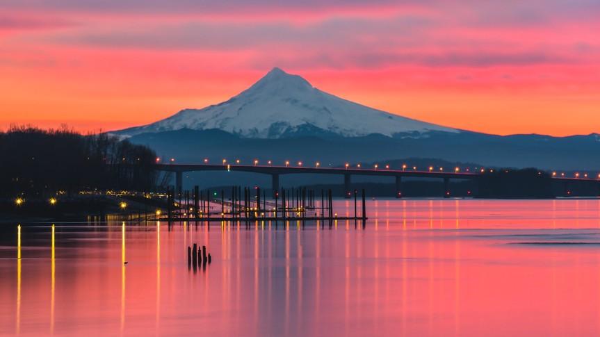 A vibrant pink sunrise over the Columbia River and Mt Hood, Portland Oregon.