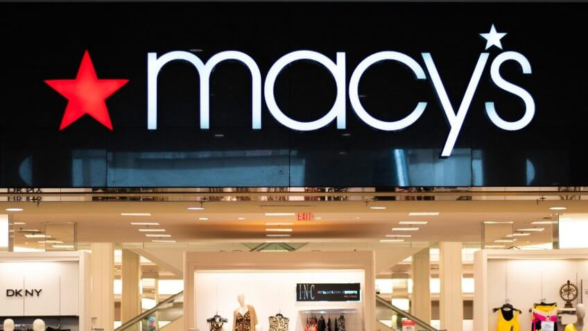 Providence, Rhode Island, USA - June 29, 2019: Macy's Store Logo Lighted Display Sign Above Entrance In White Letters On Black Background And Red Star.