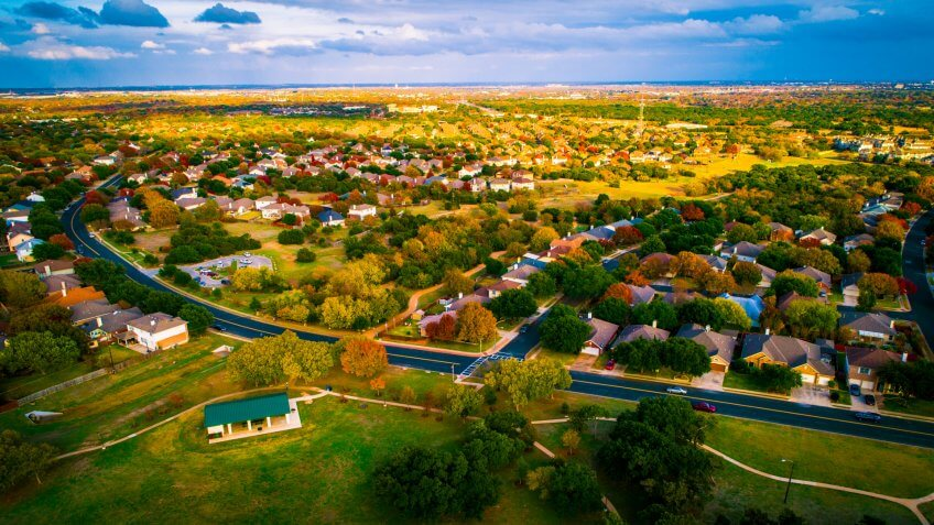 open Texas land for sale expanding housing development fall Autumn suburb suburbia round Rock Texas colorful landscape trees changing colors fall in central texas.